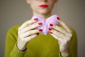 Close up on pink heart in hand of woman. Image of Valentines day