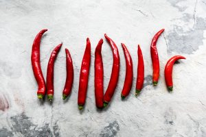 Aerial view of cayenne chili peppers on grunge background